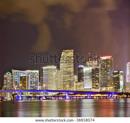 Colorful night scene of the financial district in downtown Miami Florida - stock photo