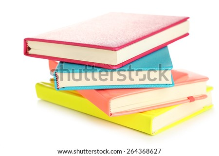 Colorful notebooks, isolated on white - stock photo