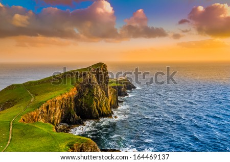 Colorful ocean coast sunset at Neist point lighthouse, Scotland, United Kingdom - stock photo