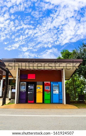 Colorful of Automated teller machine on sky background  - stock photo