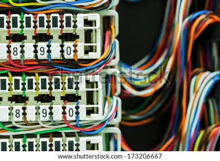 Colorful of copper cables connect to connector used in telecommunications - stock photo