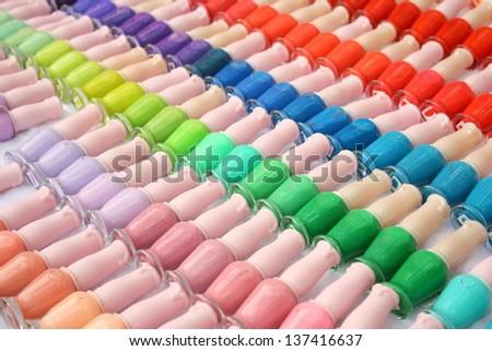 Colorful of nail polish or nail varnish Arrangement of nail polish on table - stock photo