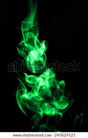 Colorful of smoke on black background. - stock photo