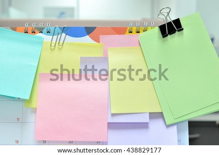 Colorful of sticky notes on calendar at business office with copy space for text. - stock photo