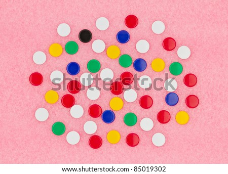 Colorful of thumb tack on pink board. - stock photo