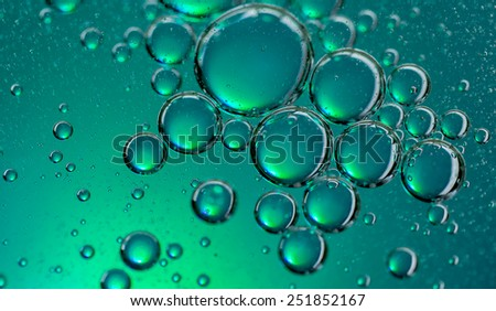 Colorful oil drops on a water surface - stock photo