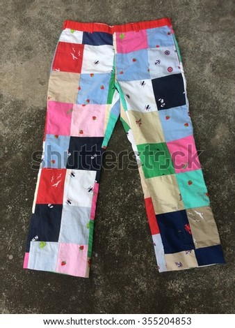 Colorful old fashion pant design on floor - stock photo
