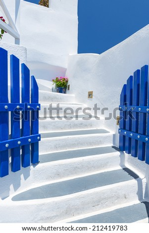 Colorful Old Staircase And Traditional Architecture On Island of Santorini in Fira, Greece. - stock photo