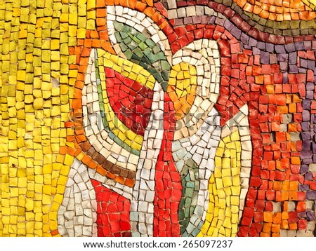 Colorful old stone mosaic on the wall, bright tiles, floral theme - stock photo