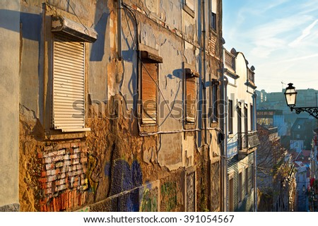 Colorful Old Town wall of Lisbon at sunset. Portugal - stock photo