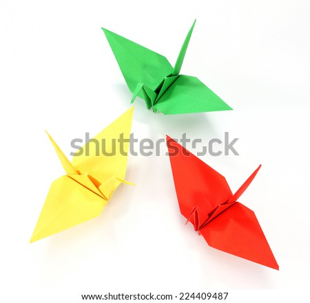 colorful Origami cranes on white background - stock photo