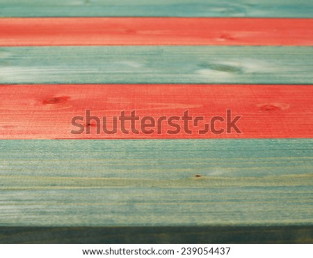 Colorful paint coated pine wood boards fragment as a background composition with a shallow depth of field - stock photo