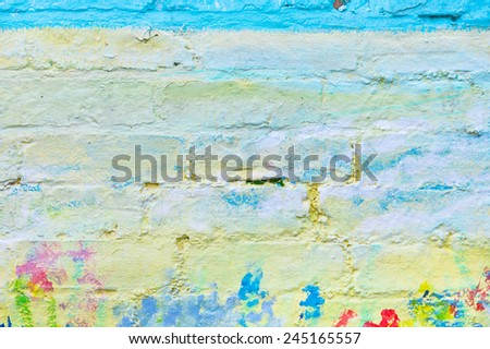 Colorful paint marks on a brick wall - stock photo