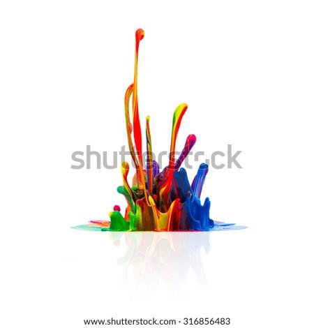 Colorful paint splashing isolated on white background - stock photo