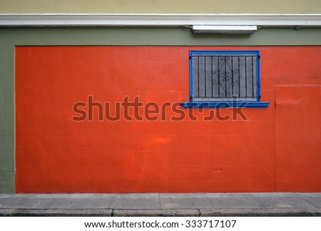 colorful painted wall and window - stock photo