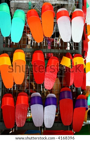 colorful painted wooden chinese clogs - stock photo