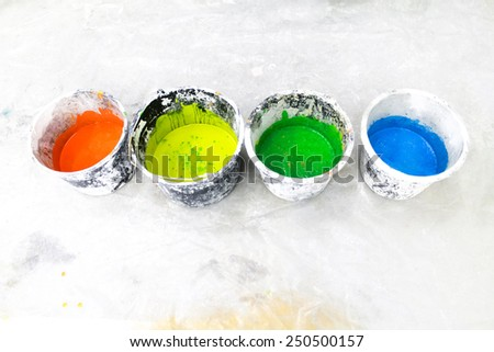 Colorful paintings in buckets - stock photo