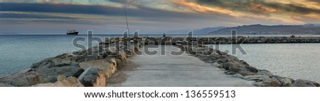 Colorful panoramic view on the Red Sea from the central beach of Eilat - famous resort and recreation city in Israel - stock photo
