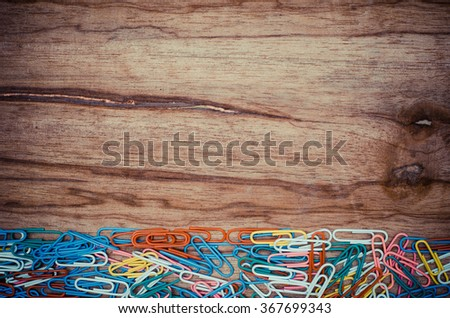 Colorful Paper Clip on wood board - stock photo