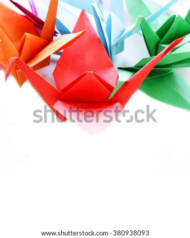 colorful paper origami birds on a white background  - stock photo