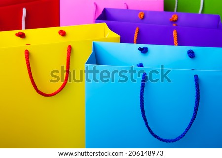 Colorful paper shopping bags with copy space. Pink, blue, red, yellow and green shopping bags. - stock photo