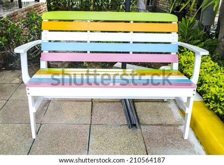 Colorful park bench - stock photo