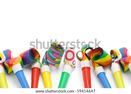Colorful party blowers border with copy space - stock photo