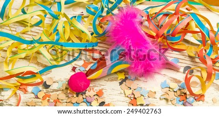 Colorful party decoration with hat, streamer and confetti - stock photo