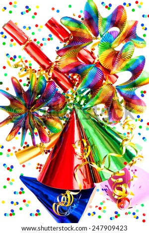 colorful party items garlands, streamer, cracker, hats and confetti. festive holidays decoration background - stock photo