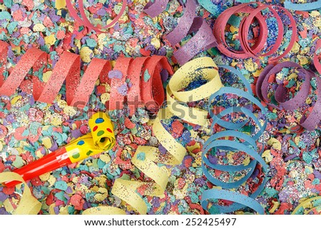 colorful party streamers on confetti - stock photo
