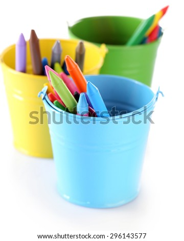 Colorful pastel crayons in holders isolated on white - stock photo