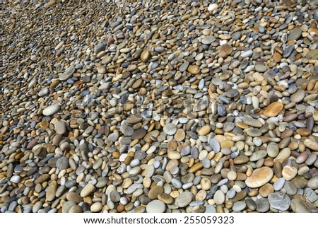 colorful pebble stone background, at the beach - stock photo