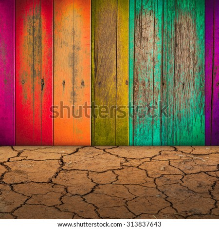 colorful peeling paint wood wall and dry soil for background - stock photo