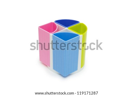 Colorful pencil holder isolated on white - stock photo