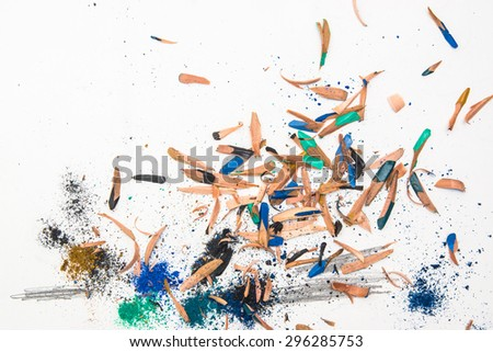 Colorful pencil wood shavings with blue, green, beige  crumbs on a white background  - stock photo