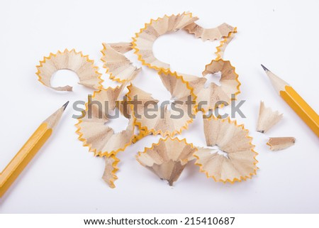 colorful pencils and pencils shaving on white background - stock photo