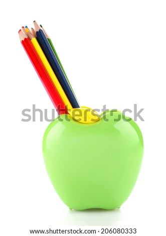 Colorful pencils in green apple shaped holder isolated on white - stock photo