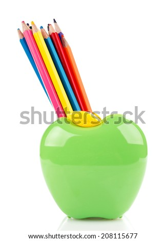 Colorful pencils in green apple shaped stand isolated on white - stock photo