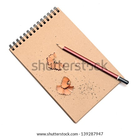 colorful pencils on brown packing paper background, carton notebook - stock photo