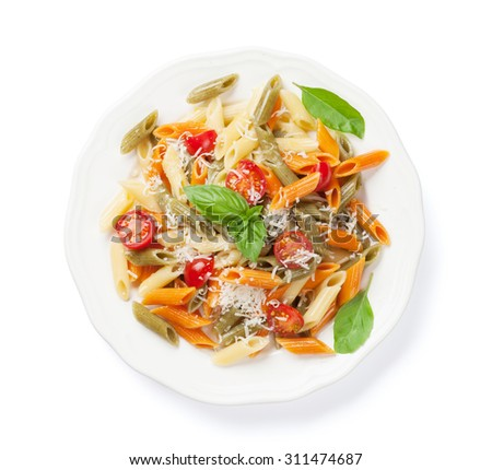 Colorful penne pasta with tomatoes and basil. Isolated on white background - stock photo