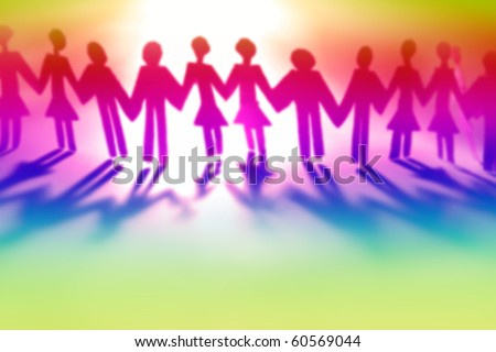 Colorful people holding hands together (blurred) - stock photo