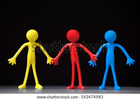 Colorful People on black background. Close up. - stock photo