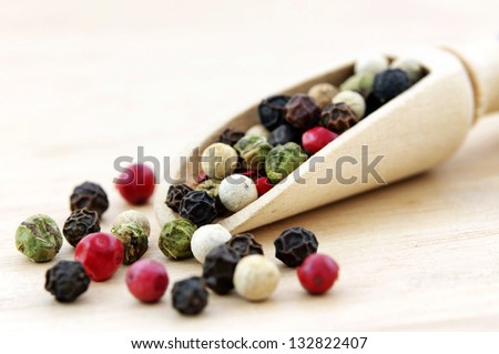 Colorful Peppers Mix in wooden scoop - stock photo