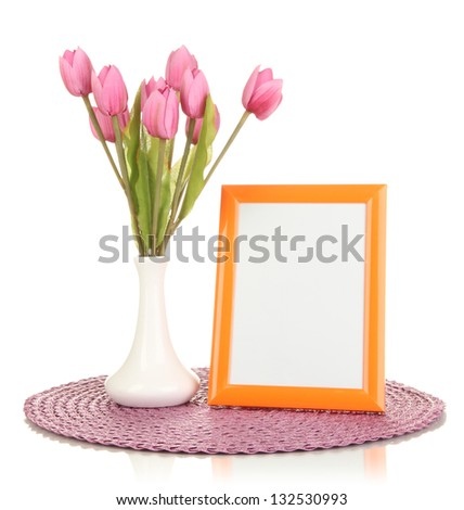 Colorful photo frame and flowers isolated on white - stock photo