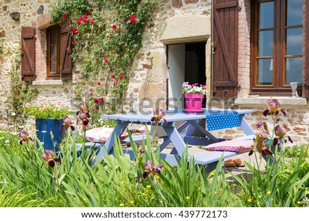 Colorful picnic table in the French garden - stock photo