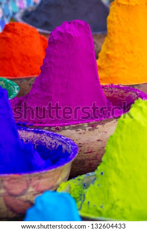 Colorful piles of powdered dyes used for Holi festival in India - stock photo
