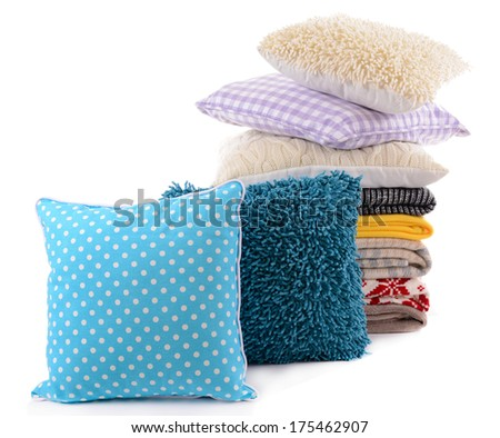 Colorful pillows and plaids isolated on white - stock photo