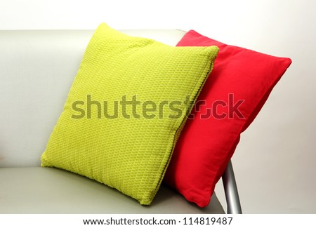 Colorful pillows on couch isolated on white - stock photo