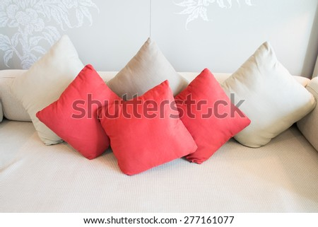 colorful pillows on sofa in living room - stock photo