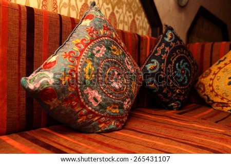 Colorful pillows on the couch in the uzbek restaurant - stock photo